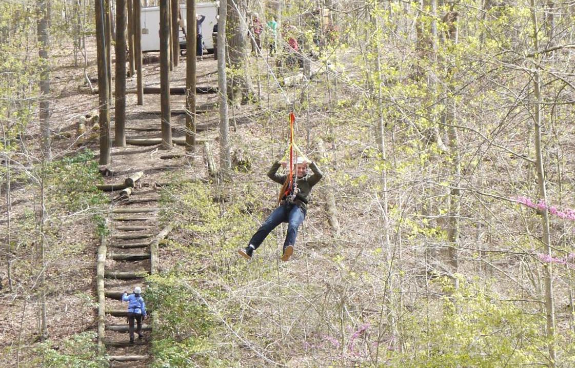 image of man ziplining in woords